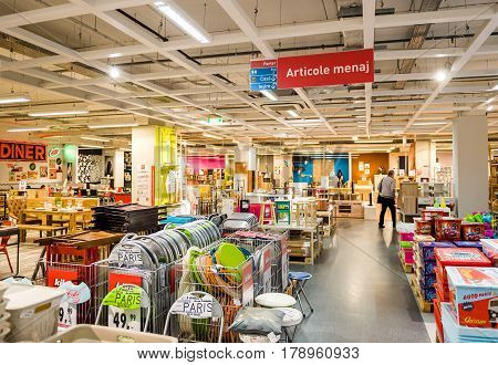BUCHAREST ROMANIA - APR 1 2016: Silhouette of senior man buying furniture inside KIKA furniture store in Bucharest selling ready-to-assemble furniture kitchen appliances and home accessories