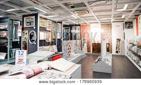 BUCHAREST ROMANIA - APR 1 2016: Interior of KIKA store selling diverse models of tapestry rug mat and other ready-to-assemble furniture kitchen appliances and home accessories