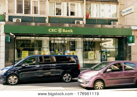 BUCHAREST ROMANIA - APR 1 2016: Cars driving fast on Bucharest boulevard with CEC bank agency in the background. CEC Bank is a state-owned Romanian banking institution