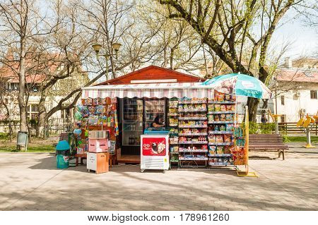 BUCHAREST ROMANIA - APR 1 2016: Woman selling sweets biscuits and soda water in boutique located in Parcul Pita Romana in central Bucharest