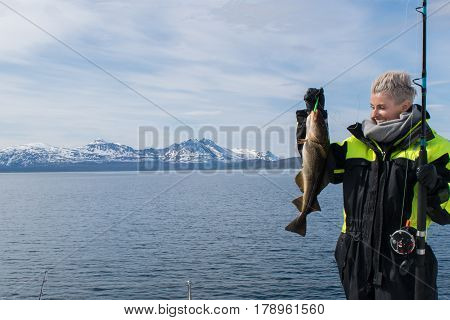 Girl at fishing trip in Tromso inside the artic circle