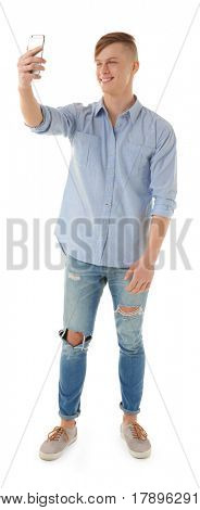 Handsome young man taking selfie on white background
