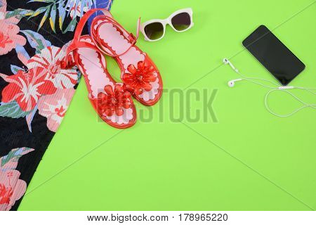 Fashion. Summer woman accessories-Summer floral scarf, shoes,hat, sunglasses,phone,on green background