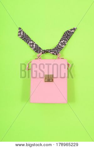 Fashion handbag-green background
