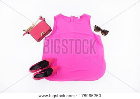 female shoes with pink shirt,sunglasses and bag