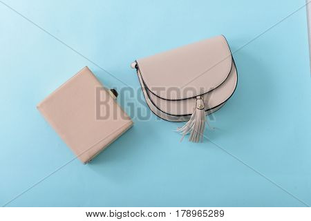 Clutch handbag-blue background