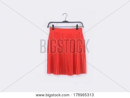Red flared skirt on clothes rack isolated