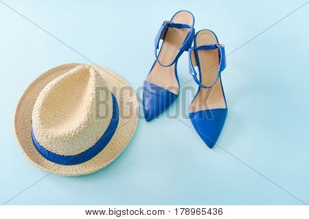Stilish hat with shoe for women-blue background