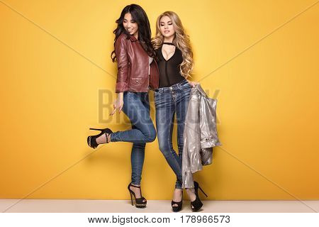 Two Fashionable Girls Posing.