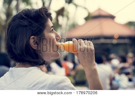 Woman leisure in a park drinking juice