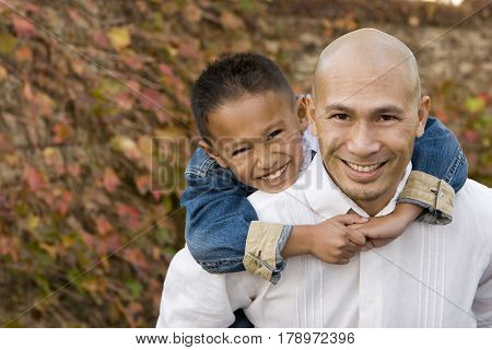 Portrait of an Asian father and his little boy.