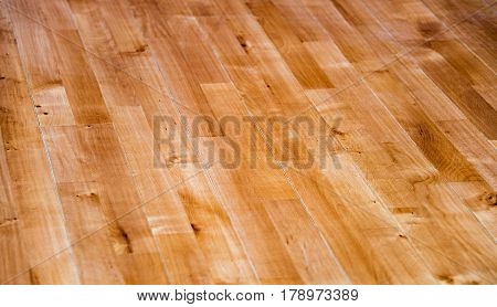 Home a beautiful interior hardwood floor. Wood flooring. Lines of hardwood floor. Close-up of oak hardwood floor. Natural hardwood floors.