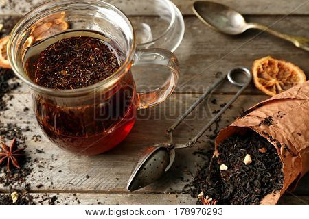 Set for brewing tea on wooden background