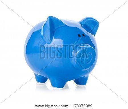 Blue ceramic piggy bank on white background