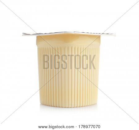 Plastic cup with yogurt on white background