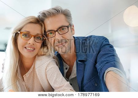Portrait of happy middle-aged couple with eyeglasses