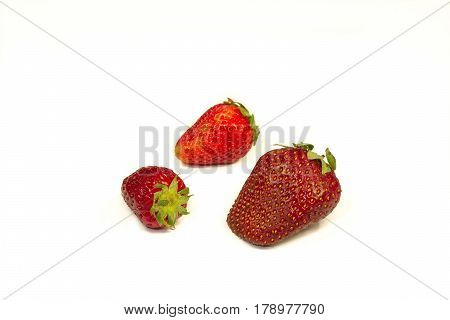 Red strawberries on a table on a white background