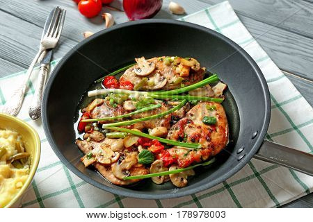 Pan with tasty chicken marsala on table