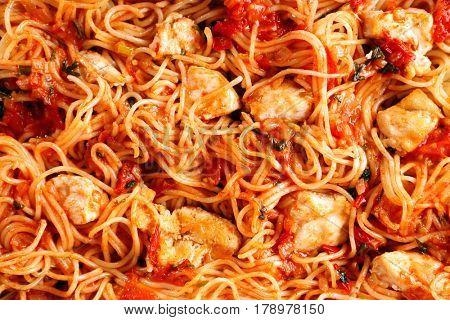 Delicious chicken spaghetti with tomato sauce, closeup