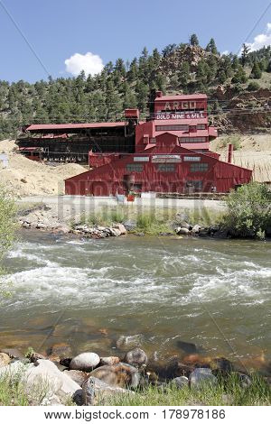 Idaho Springs CO USA - June 24 2016: A red painted historical gold mine mill and mining museum. The historical gold mine is a major attraction in Idaho Springs.