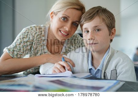 Woman helping son with homework