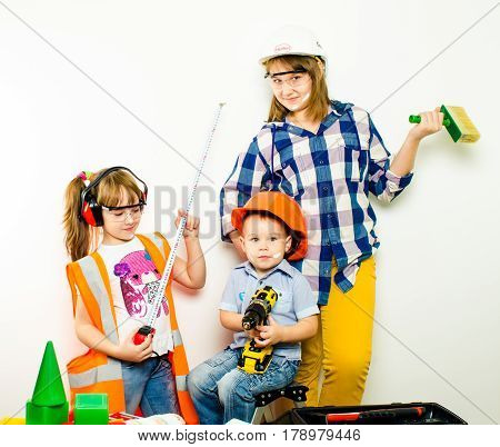 A group of children with construction tools isolate of white background.