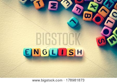colorful english word cube on white paper background English language learning concept