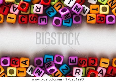 colorful english alphabet cube on white paper background English language learning concept