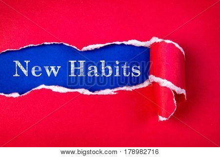 Torn red Paper and New Habits text with a blue paper background