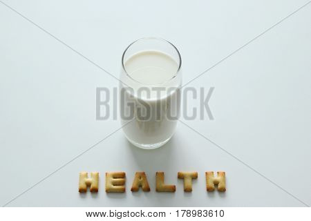 A Glass Of Milk With Inscription From The Cookies On The White Background.