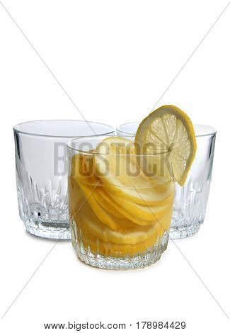 Glass jars with lemon on a white background