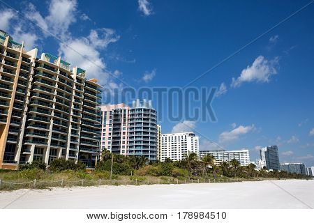 Hotels and condominiums line the white sandy Miami South Beach Florida USA.