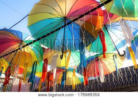 Display of brightly coloured umbrellas at the Chew Jetty Penang