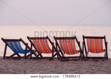 Deck chairs at the beach of Cha-Am, Hua Hin, Thailand