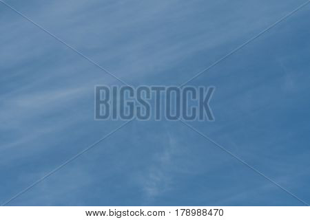 Wisps of Clouds in Blue Sky background image