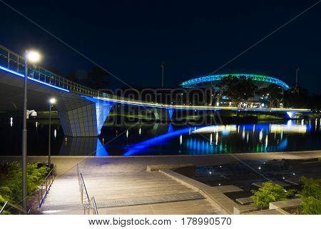 Adelaide South Australia Australia - January 1 2015: Night time lights on the Adelaide Oval foot bridge over the Torrens River and the Adelaide Oval.