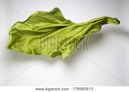 abstract piece of green fabric flying, art object, design element