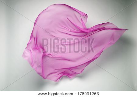 abstract piece of pink fabric flying, art object, design element