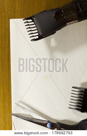 Tools for cutting hair on a white sheet of paper