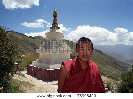 Lhasa, Tibet, China - September 2011: Tibetan monk of Buddhist monastery Druk Yerpa near the ritual construction Stupa on September 2011 in Lhasa, Tibet, China.