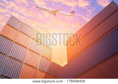 Cargo Flight Flying Over Colourful Stack Of Cargo Shipping Containers In Shipping Yard.photo Concept