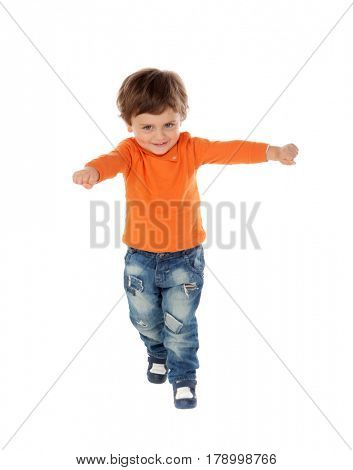 Beautiful little child two years old wearing jeans and orange jersey runing isolated on white background