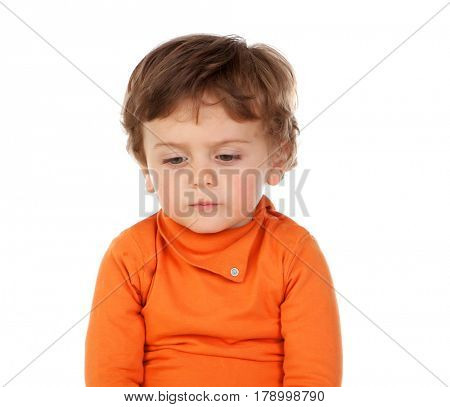 Sad funny baby with orange jersey isolated on a white background