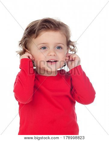 Beautiful little child two years old touching his ears isolated on a white background