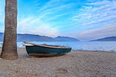 Green boat on sands of Marmaris beach in Marmaris Turkey poster