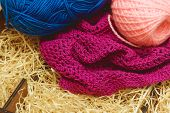 Hanks of bright yarn for knitting on a bright background. poster