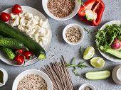 Vegetarian food set. Zucchini cauliflower sweet pepper soba noodles quinoa buckwheat - healthy vegetarian food. On a gray background top view poster