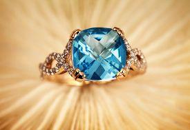 Elegant female jewelry rings with jewel gem stone blue topaz