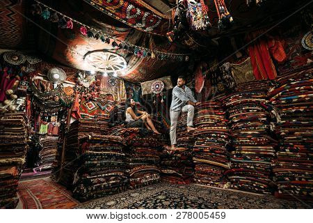 Guy And Girl In The Store. Couple In Love In Turkey. Man And Woman In The Eastern Country. Gift Shop