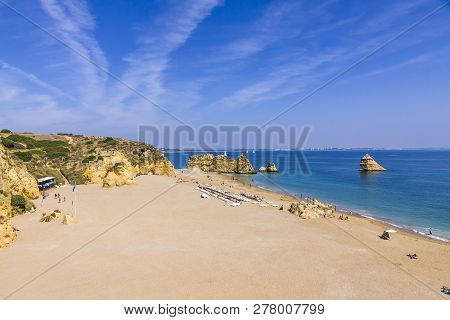Praia Da Dona Ana Beach, Lagos, Algarve Region, Portugal. Praia Dona Ana Surrounded By Steep Colourf